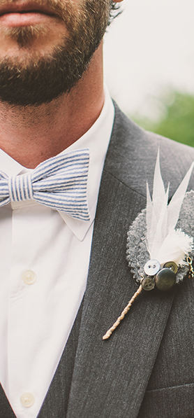 man in wedding suit and bow tie