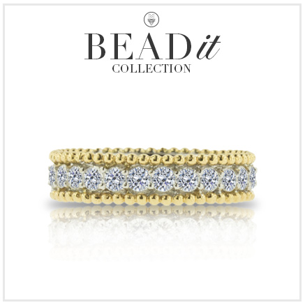 yellow gold and diamond ring with reflection